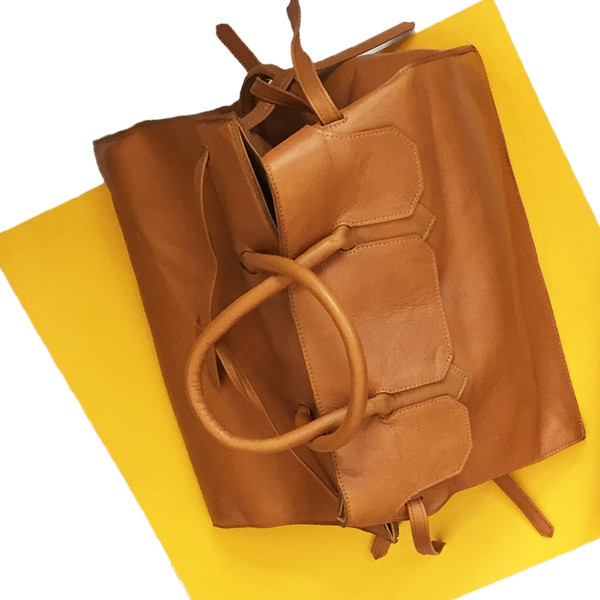 Slow and Steady Wins the Race Four Sided Rectangular Bag in Camel