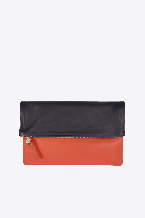 Clare V. Foldover clutch in navy & poppy