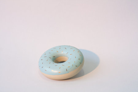 YYY blue donut with gold sprinkles