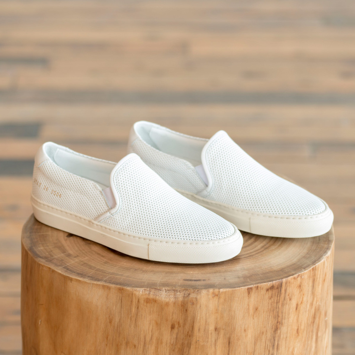9f81924078f3 Woman by Common Projects Slip on Perforated Leather