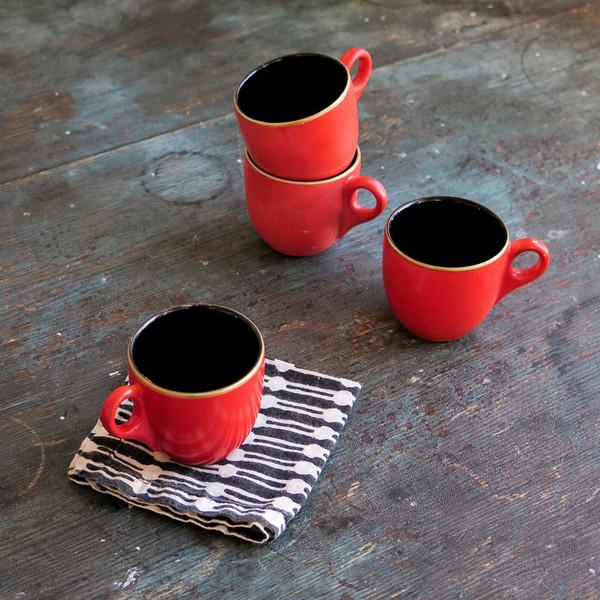gold-rimmed espresso cups