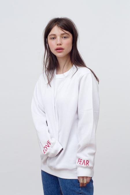 Unisex Vender Love vs Fear sweatshirt