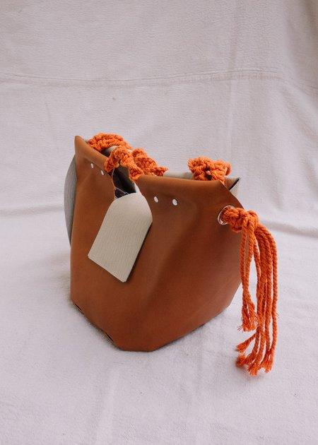 IL Cigno Nero Bucket Bag with macrame handle