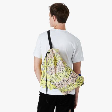 COMME des GARÇONS SHIRT x KAWS Drawstring Bag - Yellow/Multi