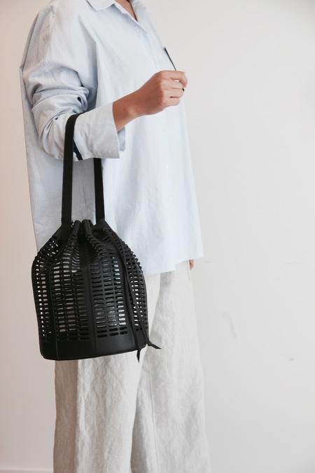 MODERN WEAVING OVAL DIE CUT BUCKET BAG