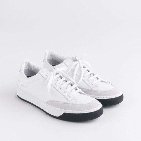 WOMAN BY COMMON PROJECTS TENNIS PRO IN WHITE & BLACK