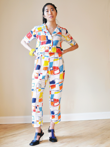 One Imaginary Girl Loved Geometric Primary Print Jumpsuit